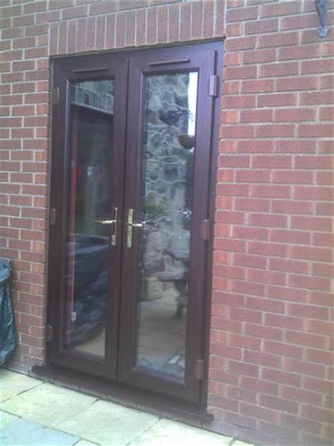 rosewood french doors  side opening windows