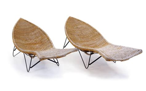 pair of wicker or and iron fish shaped outdoor or