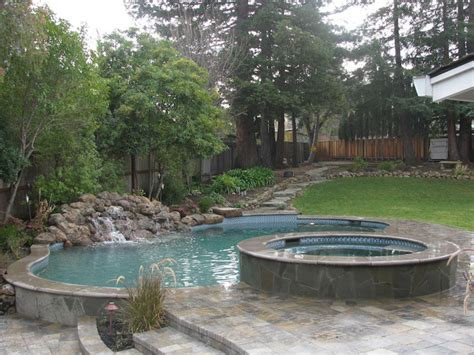 Pool, Spa & Waterfall In Sloped Yard Mediterranean-pool