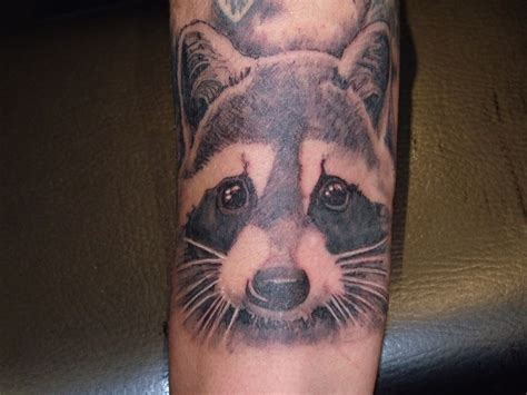 cute raccoon arm tattoojpg