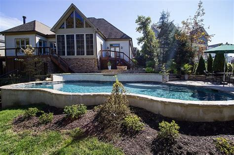 Lovely Pool Built On A Lot With Extreme Yard Slope.