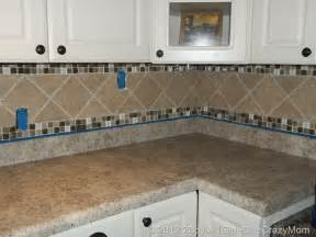 tile borders for kitchen backsplash simple kitchen area with brown ceramic glass border tile backsplash brown granite kitchen