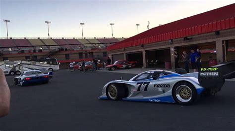 Mazda factory race cars leaving paddock for demo run at