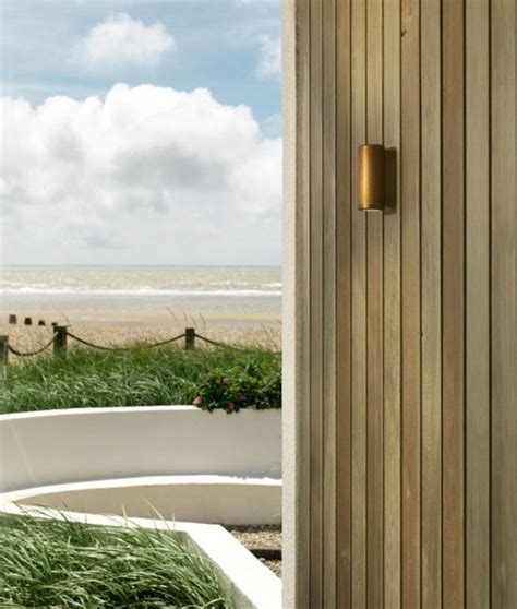 up down coastal wall light in antique brass or nickel finish