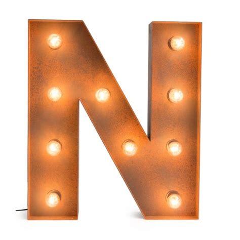 wooden tables letter n with light bulb reallynicethings