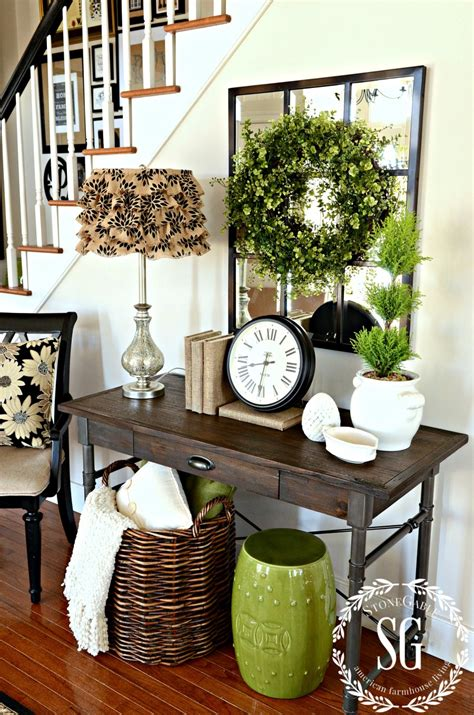 foyer decor boxwood wreath in the foyer and a giveaway