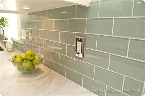 White marble counter w/ green subway tiles. I like the