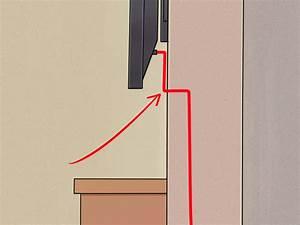 Fernseher An Die Wand Hängen Ohne Halterung : einen flachbildfernseher ohne sichtbare kabel an die wand ~ Michelbontemps.com Haus und Dekorationen