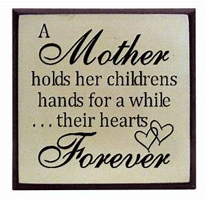"""""""A Mother holds her childrens hands """""""