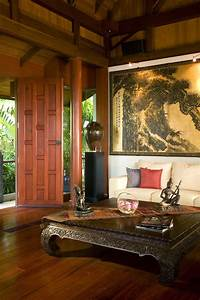 an asian style living room with a tall stained wood With interior designer cost plus