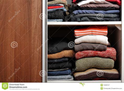 open wardrobe  lots  folded clothes royalty