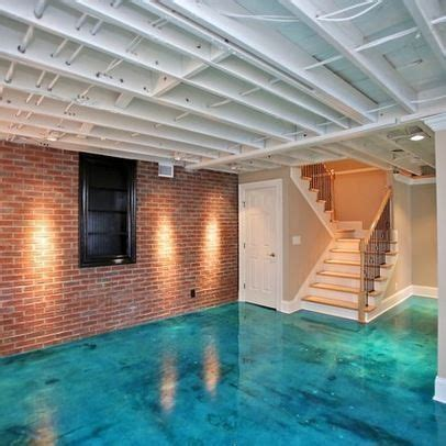Love the exposed ceiling and bright floor   Basement