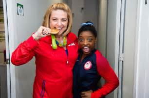 Coach with Her Picture of Simone Biles