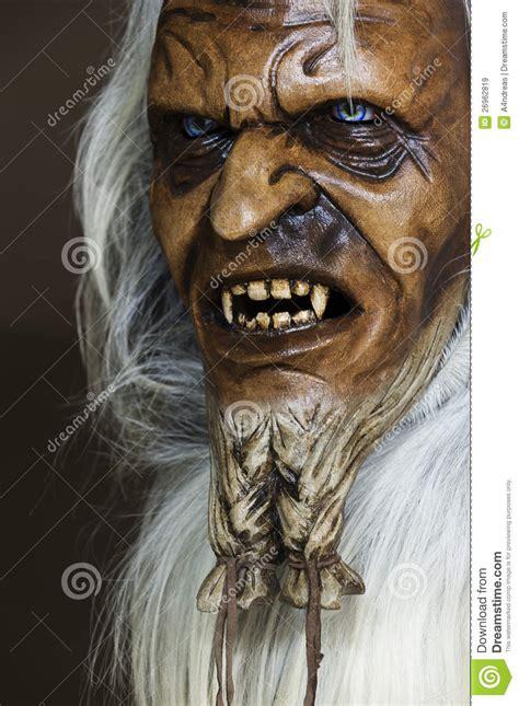 satanic wooden mask   companion st nicholas stock
