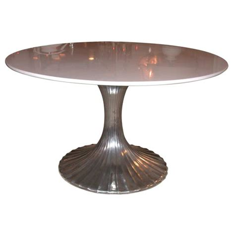 aluminum base dining table with white granite top at