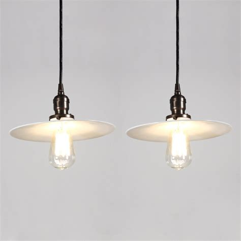 two matching antique industrial pendant lights with milk