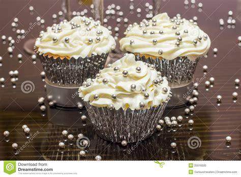 white cupcakes  silver decorative sprinkles stock
