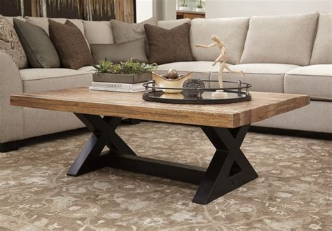 They're also very useful pieces of furniture for placing. Signature Design Wesling Light Brown Wood Coffee Table by Ashley