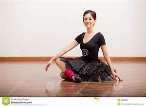 Beautiful ballerina taking a break royalty free stock for Dance where you sit on the floor