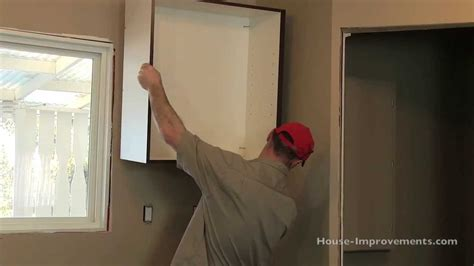 how to hang cabinets how to install kitchen cabinets youtube