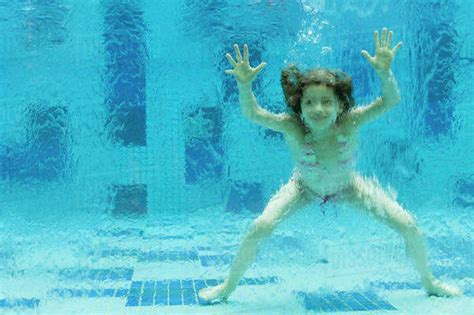 Girl Swimming Underwater In Swimming Pool Stock Photo