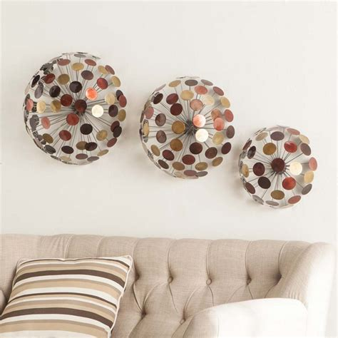 Available in a set of three, this alternative metal wall decor can be hung together to bring life to any. Southern Enterprises Jessalyn 3 Piece Metal Sphere Wall ...