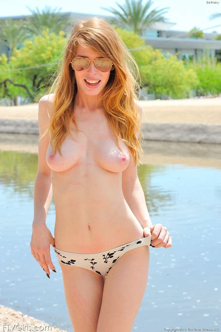 Busty Redhead Enjoys Posing Nude And Teasing With Her