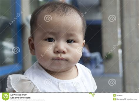 funny face  asian baby  home living room stock image