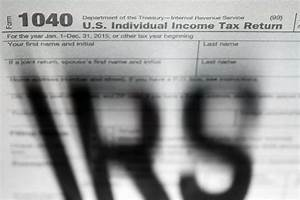IRS to delay tax refunds for millions of low-income ...