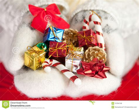 small christmas gifts in palms of hands royalty free stock