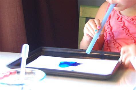 painting with straws in preschool tinkerlab 642   blow painting preschool