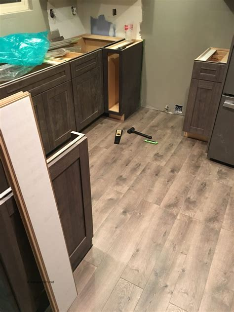 step laminate flooring for kitchens step by step process for how to install laminate flooring 9190