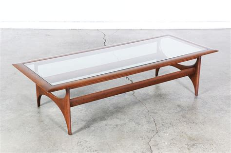 This beautiful midcentury coffee table was made in the 1970s in germany. Mid Century Sculptural Coffee Table w/ Glass Top by Lane | Vintage Supply Store