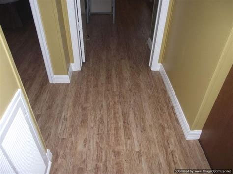 Kensington Manor Laminate Wood Flooring by Kensington Manor Laminate Flooring Flows Into Hallway And