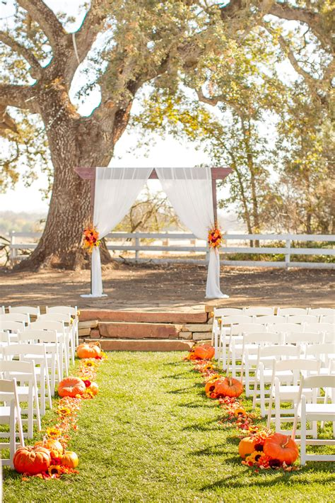 fall ceremony with pumpkins fall leaves flowers and