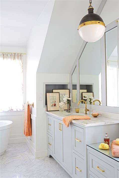 Grey Bathroom Fixtures by Bright Bathroom With Brass Fixtures And Neutral Painted