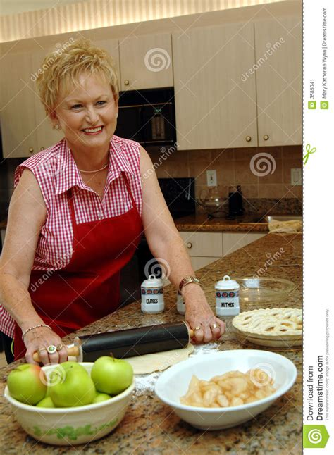 mom cooking apple pie stock image image