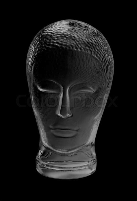 Human head made of glass in black back | Stock Photo
