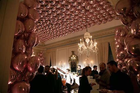 room hundreds  mylar balloons  strung