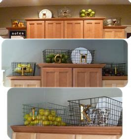 baskets on top of kitchen cabinets 17 best ideas about above cabinet decor on 9078