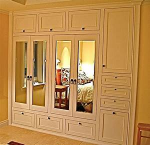 Handmade Custom Built-In His & Hers Closets by Ps