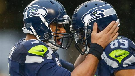 seahawks players link arms  national anthem