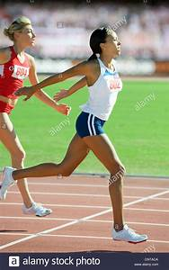 Female runner crossing finish line in race Stock Photo ...