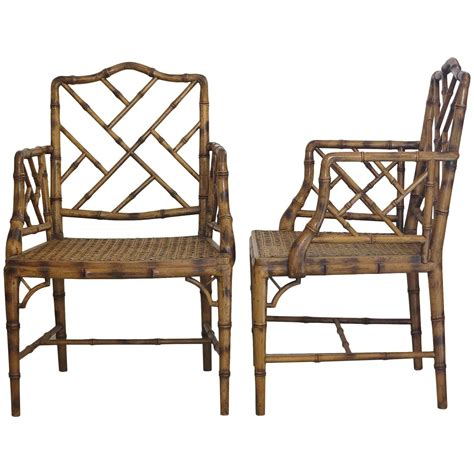 two chippendale faux bamboo arm chairs 1980s at