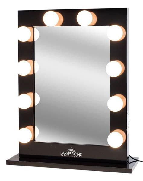mirror with studio lights reversadermcream