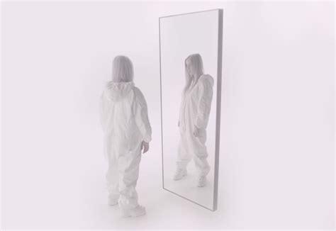 Billie Eilish Stares Herself Down In Stunning Video For