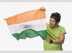 Closeup of a man holding an indian flag Stock Photo