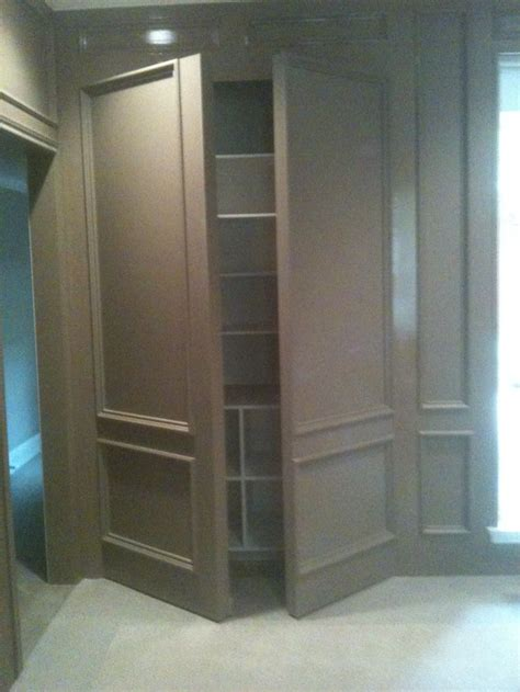 double wall panel open media room single doors flanking screen hidden doors walls