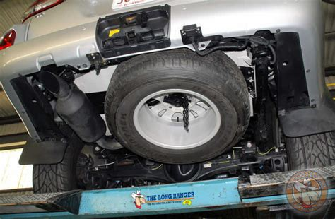 replacement fuel tank retains  spare tyre