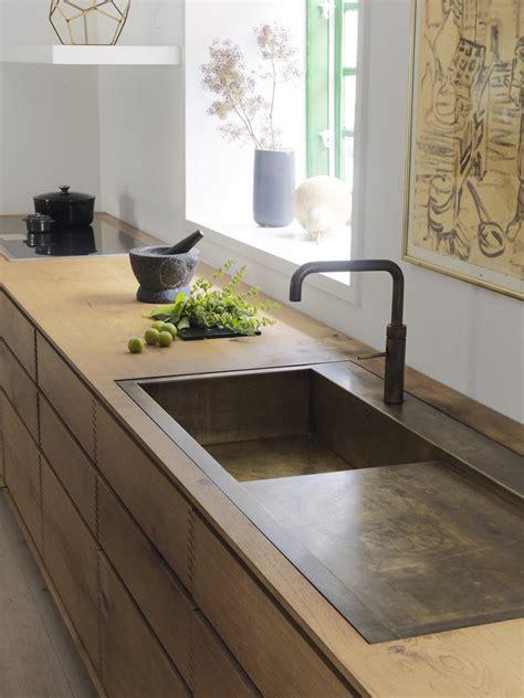 model dinesen bespoke wooden kitchen  browned brass